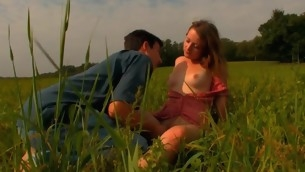Horny legal age teenager couple makes out with each other beneath blue sky