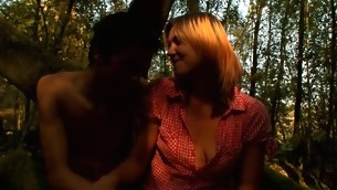 Slim golden-haired wildly enjoys the XXX fucking inside the forest
